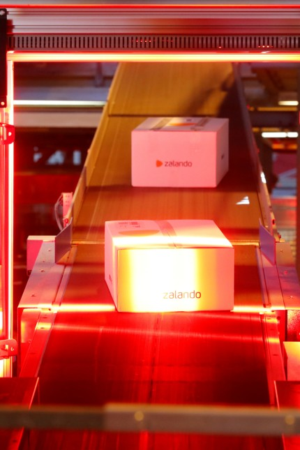 FILE PHOTO: Zalando boxes going through the Swiss Post parcel distribution centre in Frauenfeld