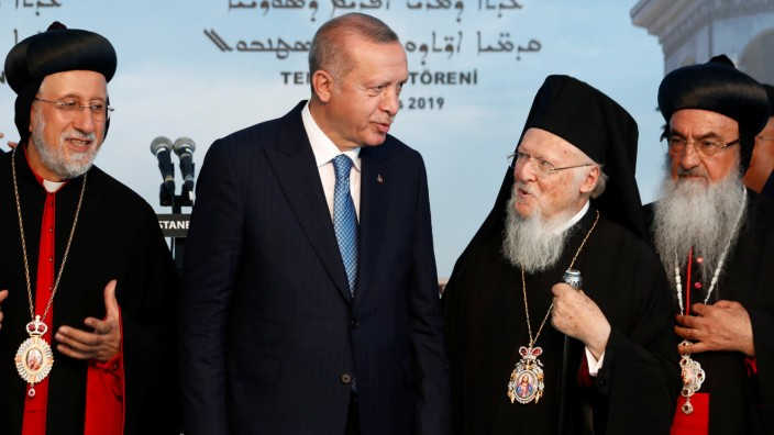 Turkish President Erdogan chats with Ecumenical Patriarch Bartholomew I during the groundbreaking ceremony of the Mor Efrem Syriac Orthodox Church in Istanbul