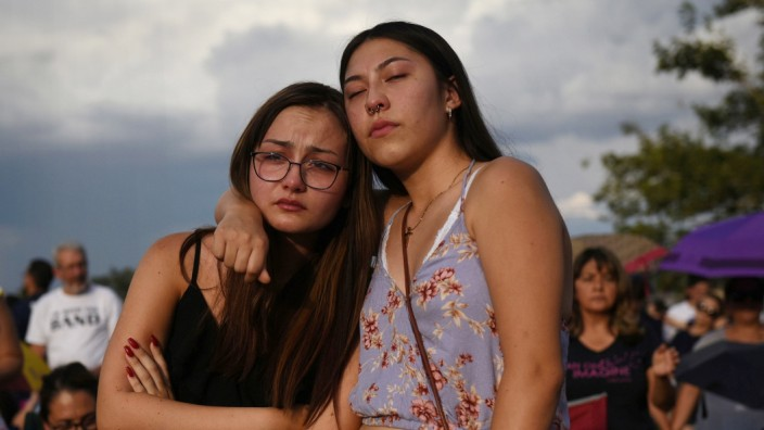 People gather for a vigil a day after a mass shooting in El Paso