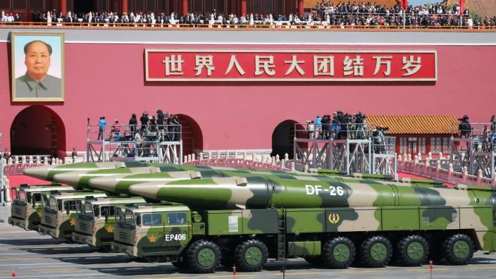 China announces 300,000 troop cuts at military parade