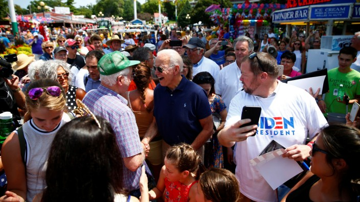 Democratic 2020 U.S. presidential candidate and former U.S. Vice President Joe Biden interacts with people at the Iowa State Fair in Des Moines