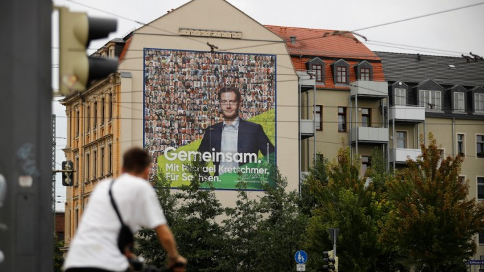 An election campaign poster for Saxony's state premier, Michael Kretschmer of the German Christian Democratic Party (CDU) is pictured in Dresden