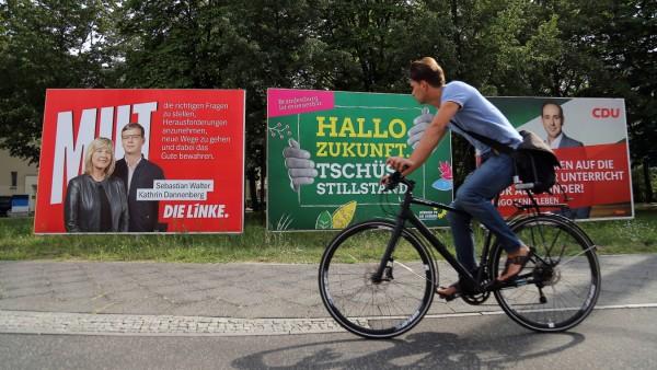 Wahlplakate von Die Linke mit den Spitzenkandidaten Kathrin Dannenberg und Sebastian Walter Bündn