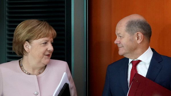 FILE PHOTO: German Chancellor Angela Merkel and Finance Minister Olaf Scholz attend the cabinet meeting in Berlin