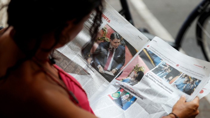 A woman reads a newspaper with news of Government crisis and the resignation of the Prime Minister Giuseppe Conte.