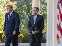 U S President Donald Trump and his Federal Reserve Chairman nominee Jerome Powell walk along the We