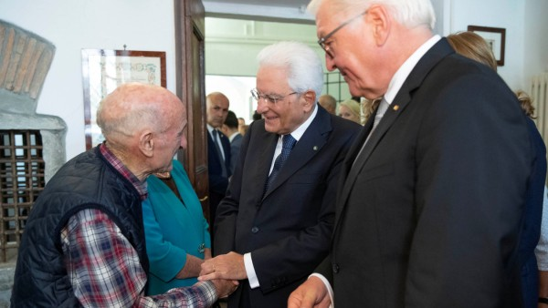 Italian President Sergio Mattarella and German President Frank-Walter Steinmeier meet a survivor during an event to commemorate the 75th anniversary of a massacre of Italian civilians carried out by the German Wehrmacht during World War II, in Fivizzano