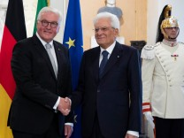 Italian President Sergio Mattarella and German President Frank-Walter Steinmeier shake hands during an event to commemorate the 75th anniversary of a massacre of Italian civilians carried out by the German Wehrmacht during World War II, in Fivizzano