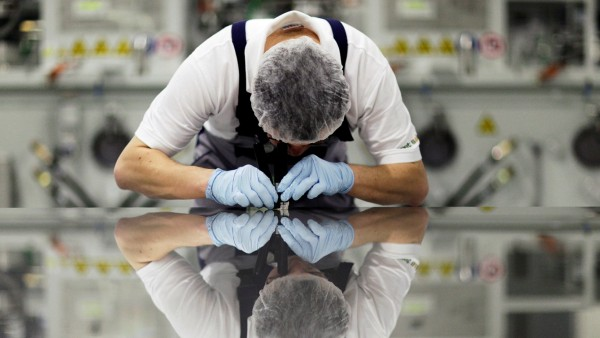 FILE PHOTO -  A worker of Signet Solar checks a photovoltaic module in a plant in Mochau, near Dresden