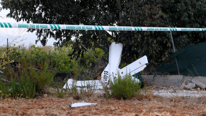 Debris and wreckage parts lay on the ground after a collision between an aircraft and a helicopter near the Village of Inca in the Spanish island of Mallorca