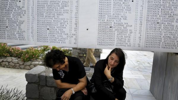 Women during memorial for war time massacre in Greece