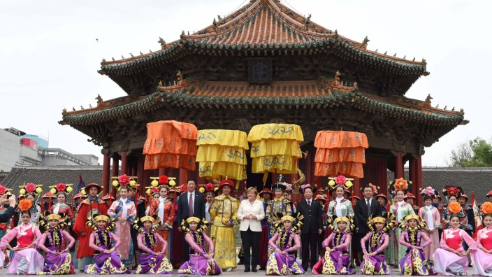 160614 SHENYANG June 14 2016 German Chancellor Angela Merkel poses for a group photo with