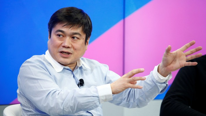 FILE PHOTO: Ito Director of the Media Lab of the Massachusetts Institute of Technology attends the annual meeting of the WEF in Davos