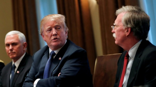 FILE PHOTO: U.S. President Donald Trump receives a briefing from senior military leadership accompanied by Vice President Mike Pence and new National Security Adviser John Bolton in Washington, DC