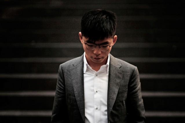 Hong Kong's pro-democracy activist Joshua Wong reacts after a news conference in Berlin