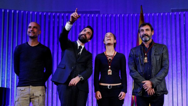 German captain of rescue ship Sea-Watch 3 Carola Rackete and Spanish NGO Proactiva Open Arms Oscar Camps pose with Catalonia's Parliament President Roger Torrent and soccer coach Pep Guardio