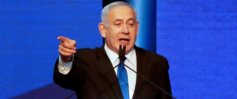 Israeli Prime Minister BenjaminNetanyahu arrives at the Likud party headquarters in Tel Aviv