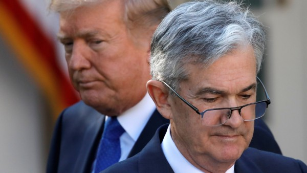 FILE PHOTO: U.S. President Donald Trump looks on as Jerome Powell, his nominee to become chairman of the U.S. Federal Reserve moves to the podium at the White House in Washington