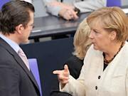 Guttenberg, Merkel, AP