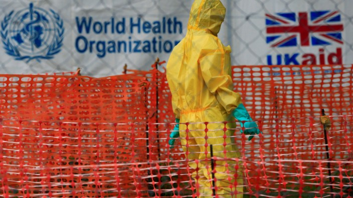 FILE PHOTO: A person dressed in ebola protective apparel is seen inside an ebola care facility at the Bwera general hospital near the border with the Democratic Republic of Congo in Bwera