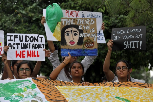 Students display placards during a 'Fridays for Future' march calling for urgent measures to combat climate change, in New Delhi