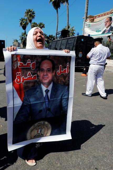 A pro Egyptian President Sisi supporter shouts slogans as they demonstrate after Friday prayers in Alexandria