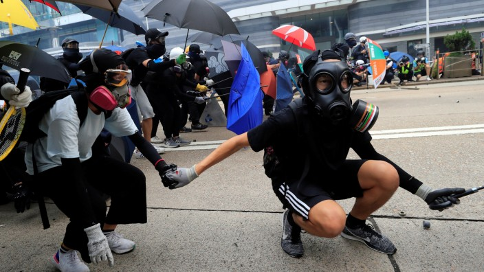 Anti-government protesters wear masks during a demonstration in Admiralty district