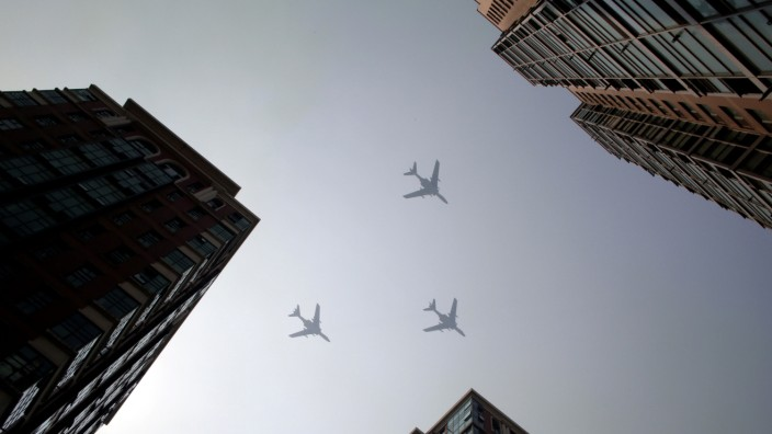 Planes from the Chinese People's Liberation Army air force fly during a rehearsal of the military parade in Beijing