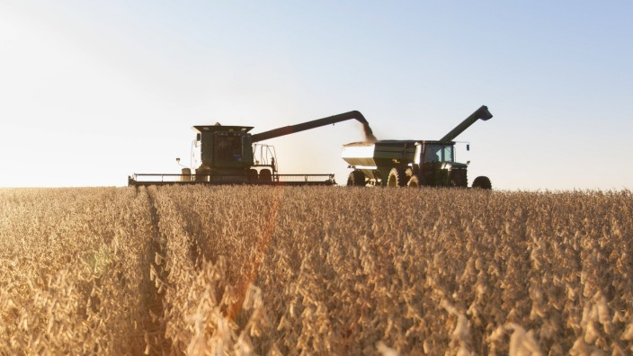 Combine picking beans during soybean harvest near Nerstrand Minnesota United States of America PU