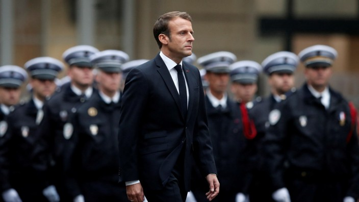 French President Emmanuel Macron attends a ceremony to honour four victims of Paris police attack