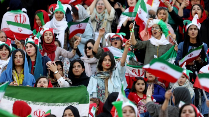 Iranian women attend Iran's World Cup Asian qualifier against Cambodia at the Azadi stadium in Tehran