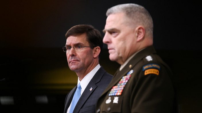 U.S. Defense Secretary Esper and Joint Chiefs Chairman General Milley address reporters at the Pentagon in Arlington