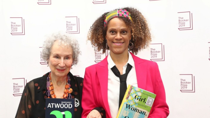 Margaret Atwood poses with Bernardine Evaristo after jointly winning the Booker Prize for Fiction 2019 at the Guildhall in London