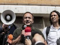 Former mayor of Riace Mimmo Lucano speacks at La Sapienza University Rome Italy