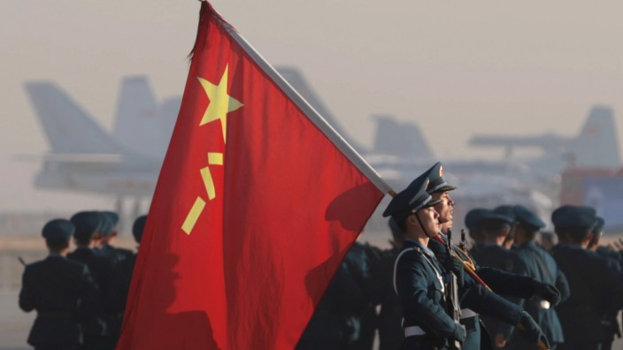 Soldiers of Chinese People's Liberation Army Air Force march during an open event marking the 70th anniversary of its founding in Changchun, Jilin