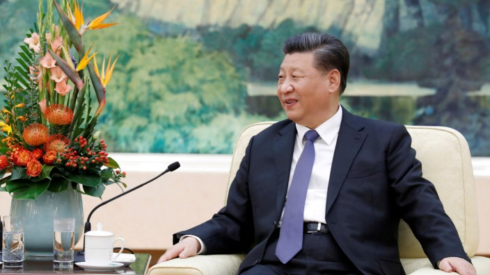 China's President Xi Jinping meets with former New Zealand Prime Minister John Key at the Great Hall of the People in Beijing