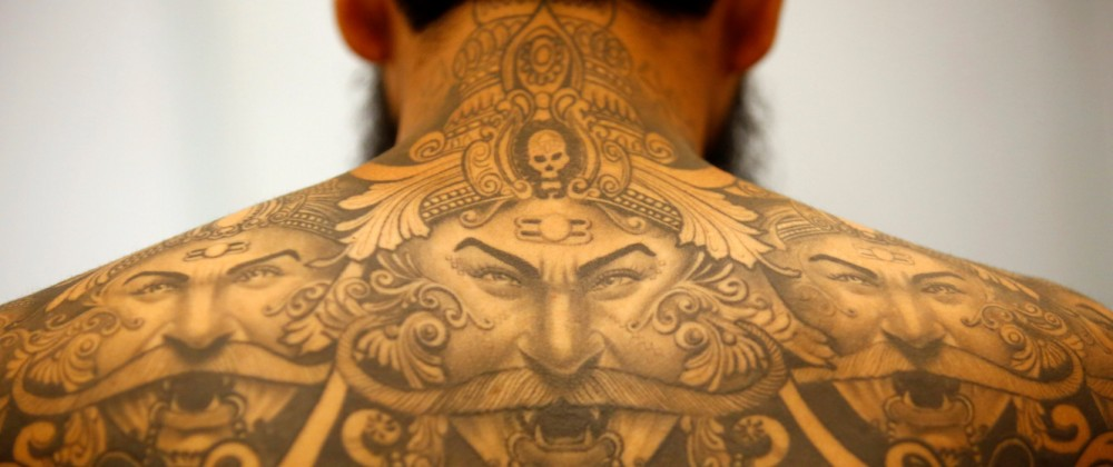 A tattoo of Hindu demon Ravan is pictured on a back of a man during the Nepal Tattoo Convention in Kathmandu