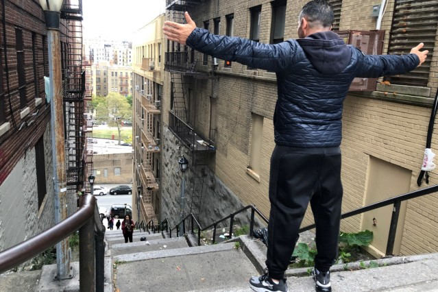 Patricio Osuna, a tourist from Tijuana Mexico, poses atop the 'Joker steps' in the Bronx