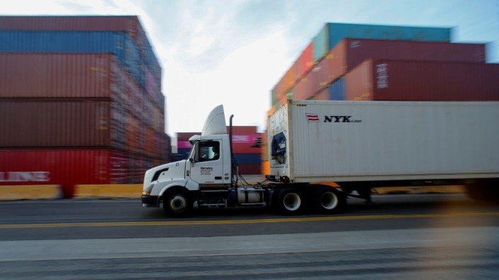 FILE PHOTO: A truck hauls shipping containers at Yusen Terminals at the Port of Los Angeles