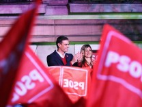 Spain's acting Prime Minister and Socialist Party leader (PSOE) candidate Pedro Sanchez gestures to supporters during Spain's general election at party headquarters in Madrid
