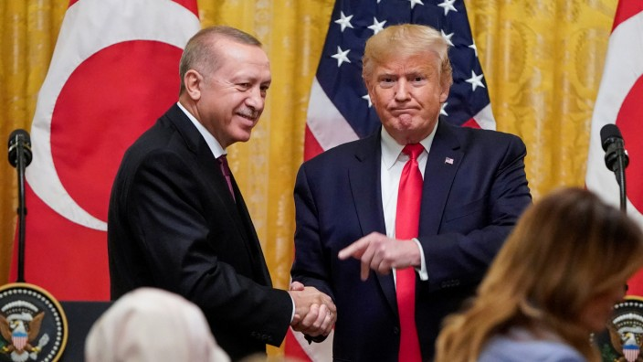 U.S. President Donald Trump and Turkey's President Tayyip Erdogan hold a joint news conference at the White House in Washington