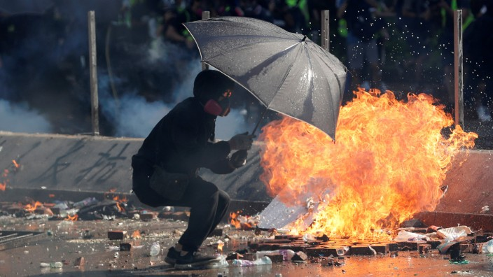 Protesters clash with police outside Hong Kong Polytechnic University (PolyU) in Hong Kong
