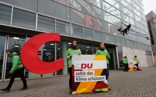 Greenpeace environmental group stage a protest in front of the party headquarters of Germany's CDU in Berlin