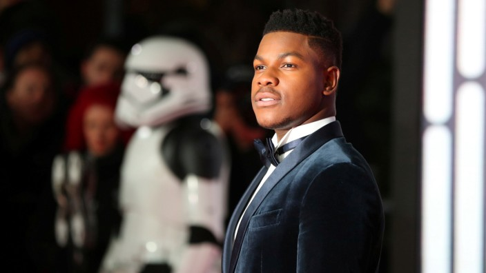 FILE PHOTO: Actor John Boyega poses for photographers as he arrives for the European Premiere of 'Star Wars: The Last Jedi', at the Royal Albert Hall in central London