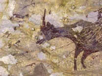 A cave painting dating back to nearly 44,000 years is seen in Leang Bulu' Sipong 4 limestone cave in South Sulawesi