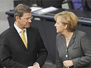 Westerwelle, Merkel, dpa