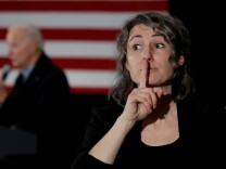 A a sign language interpreter is seen as Democratic 2020 U.S. presidential candidate and former Vice President Joe Biden speaks during a campaign event in Waterloo, Iowa, U.S.