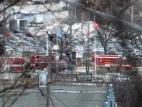 Emergency vehicles are parked near the entrance to Molson Coors headquarters in Milwaukee