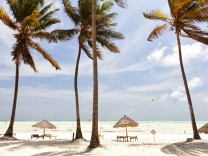 Tanzania Zanzibar Island Paje palm trees moved by the wind PUBLICATIONxINxGERxSUIxAUTxHUNxONLY DS