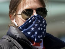 A woman wears a stars and stripes bandana for a face mask in Washington